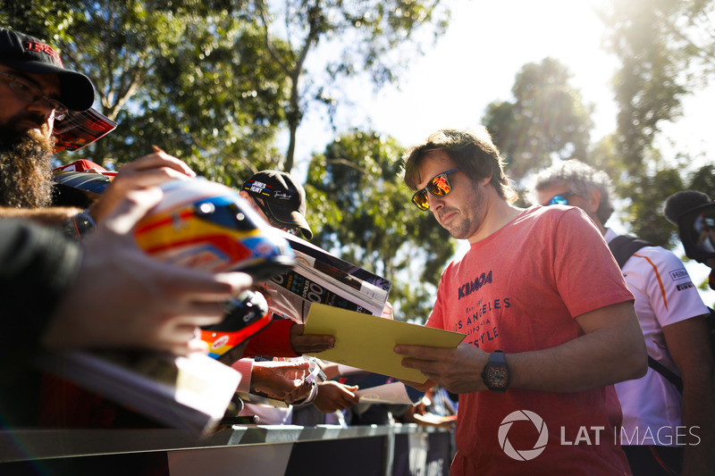 Fernando Alonso, McLaren, signs autographs