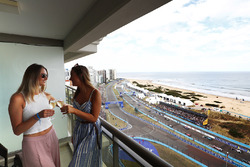 Guests enjoy a glass of champagne as the race starts