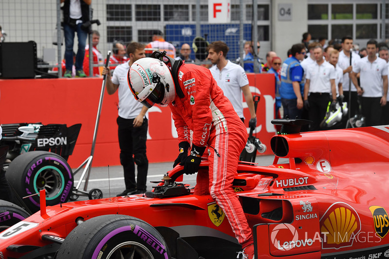 Le troisième, Sebastian Vettel, Ferrari SF71H dans le parc fermé