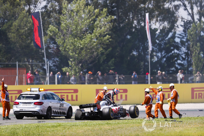 Romain Grosjean, Haas F1 Team, exits his damaged car after an opening lap accident
