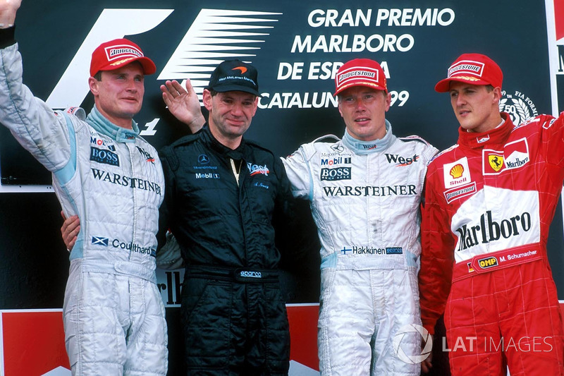 Podium: second place David Coulthard, McLaren, Adrian Newey, winner Mika Hakkinen, McLaren, third place Michael Schumacher, Ferrari