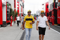 Carlos Sainz Jr., Renault Sport F1 Team, with Fernando Alonso, McLaren