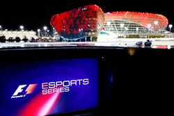 F1 Esprt logo on a screen, the circuit buildings in the background