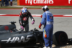 Romain Grosjean, Haas F1 Team VF-17, climbs from his car after spinning