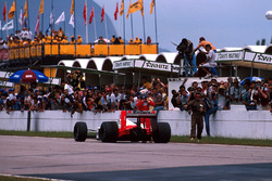 Race winner Alain Prost, McLaren MP4/4 parks his car on the start and finish straight