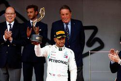 Lewis Hamilton, Mercedes AMG F1, raises his third place trophy