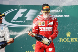 Lewis Hamilton, Mercedes AMG, 2nd Position, blasts Sebastian Vettel, Ferrari, 1st Position, with Champagne