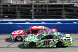 Kyle Larson, Chip Ganassi Racing Chevrolet leads Kyle Busch, Joe Gibbs Racing Toyota on a late resta