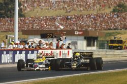Ayrton Senna (Lotus 98T Renault) overtakes Nigel Mansell (Williams FW11 Honda). They finished in 2nd