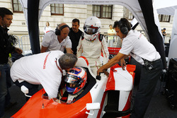 Jenson Button, McLaren, takes Naomi Campbell for a ride in a 2 seater