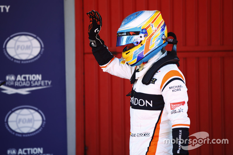 Fernando Alonso, McLaren, waves to his fans from Parc Ferme after Qualifying