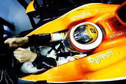 Stoffel Vandoorne, McLaren, puts on his gloves in cockpit