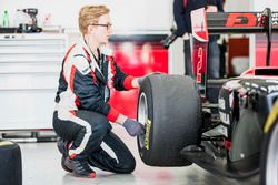An ART mechanic checks the pressure on a Pirelli tyre on the car of Nirei Fukuzumi, ART Grand Prix