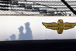 Shadows of crew members on the front straight wall