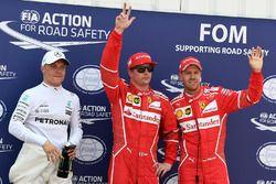 Ganador de la pole Kimi Raikkonen, Ferrari, segundo Sebastian Vettel, Ferrari y tercero Valtteri Bot