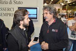 Paolo Simoncelli, padre di Marco Simoncelli, e Francesco Corghi, Motorsport.com