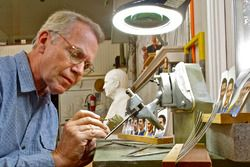William Behrends perfects the clay image of 2016 Indianapolis 500 winner Alexander Rossi before a sterling sliver image is created for the Borg-Warner Trophy