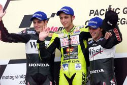 Podium: winner Valentino Rossi, second place Alex Barros, third place Loris Capirossi