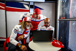 Alex Ghini, Pramac Racing hospitality manager, Federico Cappelli, press officer, and Jacopo Menghett