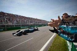 Lewis Hamilton, Mercedes AMG F1 W08, crosses the line for victory