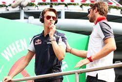 (L to R): Daniil Kvyat, Scuderia Toro Rosso with Romain Grosjean, Haas F1 Team on the drivers parade