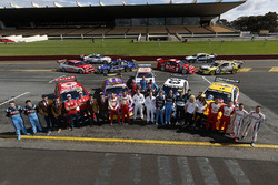 Drivers group photo with retro livery cars
