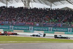 Lewis Hamilton, Mercedes AMG F1 W07 Hybrid leads at the start of the race as Nico Rosberg, Mercedes
