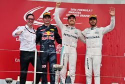 The podium (L to R): Andrew Shovlin, Mercedes AMG F1 Engineer; second place Max Verstappen, Red Bull
