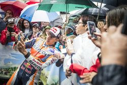 Marc Marquez, Repsol Honda poses for selfies with his fans during the MotoGP parade