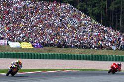 Valentino Rossi, Repsol Honda Team leads Max Biaggi, Marlboro Yamaha Team