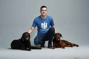 Alex Bowman with his dogs Roscoe and Finn