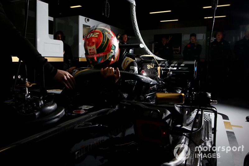 Kevin Magnussen, Haas F1 Team, enters his cockpit in the team's garage