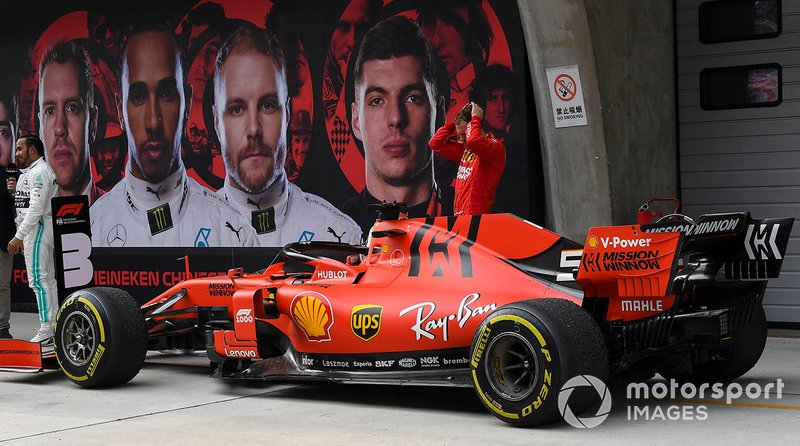 Sebastian Vettel, Ferrari, 3rd position, inspects his car in Parc Ferme