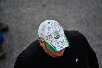 Fan with autographed hat