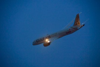 A Gulf Air Boeing 787-9 Dreamliner flys over the grid prior to the start