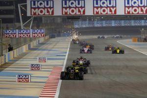Kevin Magnussen, Haas F1 Team VF-19, leads Daniel Ricciardo, Renault R.S.19, and Kimi Raikkonen, Alfa Romeo Racing C38