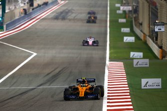 Lando Norris, McLaren MCL34, leads Sergio Perez, Racing Point RP19