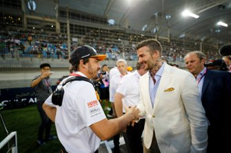 Fernando Alonso meets David Beckham on the grid