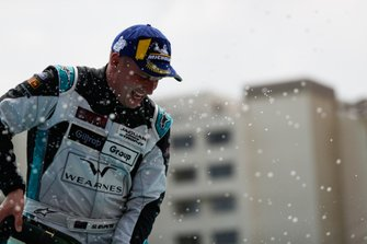 Simon Evans, Team Asia New Zealand, celebrates on the podium