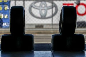 Toyota logo with tyres in the pitlane
