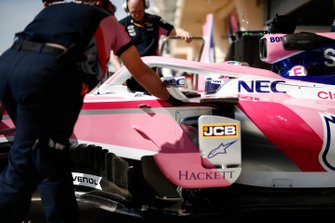 Sergio Perez, Racing Point RP19, is returned to the garage