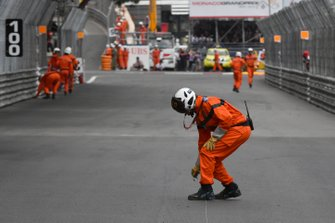 Marshals clear the track of debris