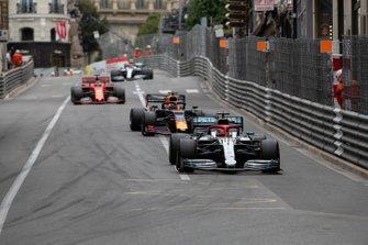 Lewis Hamilton, Mercedes AMG F1 W10, leads Max Verstappen, Renault R.S.19, and Sebastian Vettel, Ferrari SF90