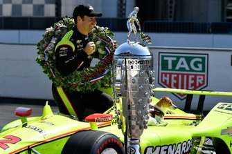 Simon Pagenaud and Norman, Team Penske Chevrolet with Borg-Warner trophy