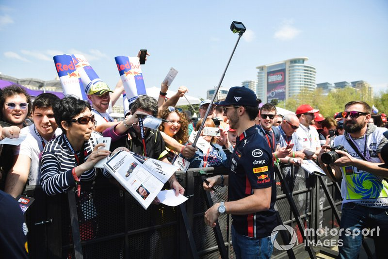 Pierre Gasly, Red Bull Racing signs an autograph for a fan