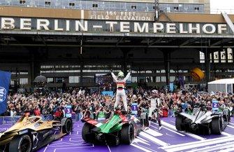 Lucas Di Grassi, Audi Sport ABT Schaeffler, celebrates victory atop his Audi e-tron FE05 next to Sébastien Buemi, Nissan e.Dams, Nissan IMO1, Jean-Eric Vergne, DS TECHEETAH, DS E-Tense FE19