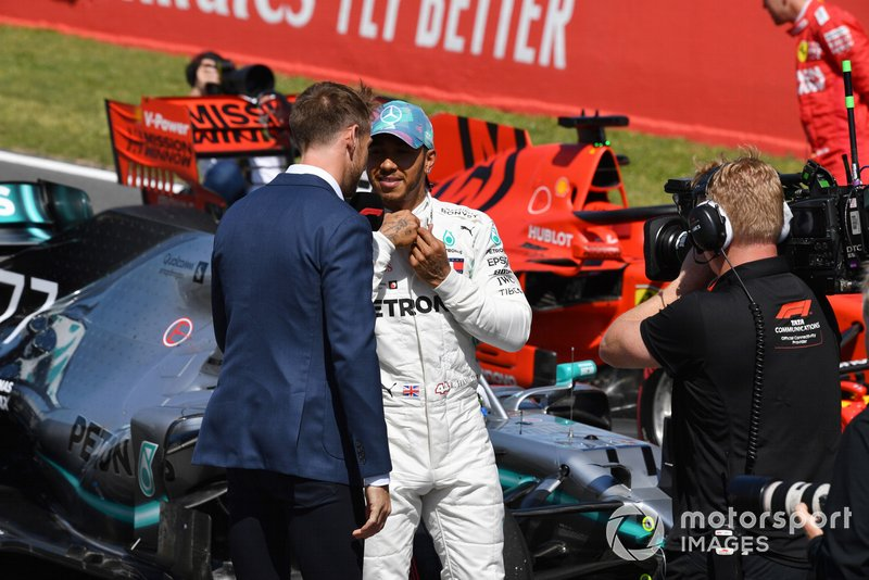 Lewis Hamilton, Mercedes AMG F1, is interviewed by Jenson Button, Sky Sports F1, after Qualifying