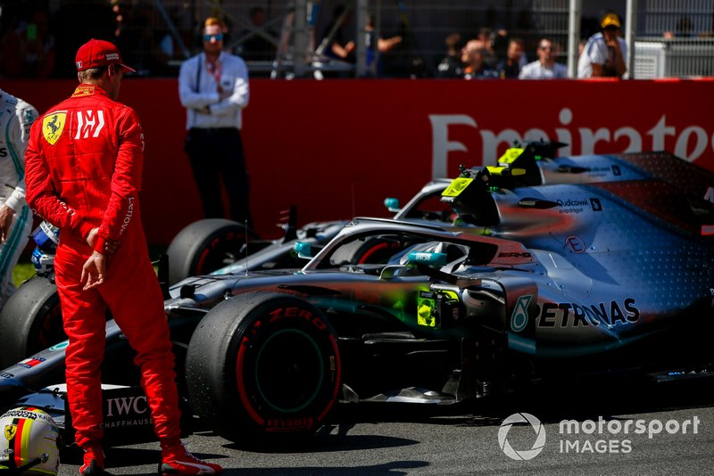 Sebastian Vettel, Ferrari looks at the car of Pole Sitter Valtteri Bottas, Mercedes AMG W10 in Parc Ferme