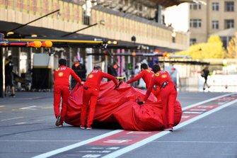 Crashed car of Charles Leclerc, Ferrari SF90 pushed down the pit lane by Ferrari mechanics