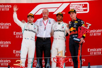 Valtteri Bottas, Mercedes AMG F1, Dr Dieter Zetsche, CEO, Mercedes Benz, Race Winner Lewis Hamilton, Mercedes AMG F1 and Max Verstappen, Red Bull Racing celebrate on the podium